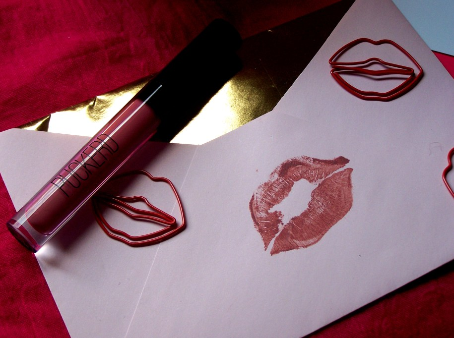 https://www.puckerd.com/ puckerd lipgloss matte lipstick lips kiss sealed with a kiss lip paperclips letter note card valentie's day love xoxo kisses pink gold tube print smooch