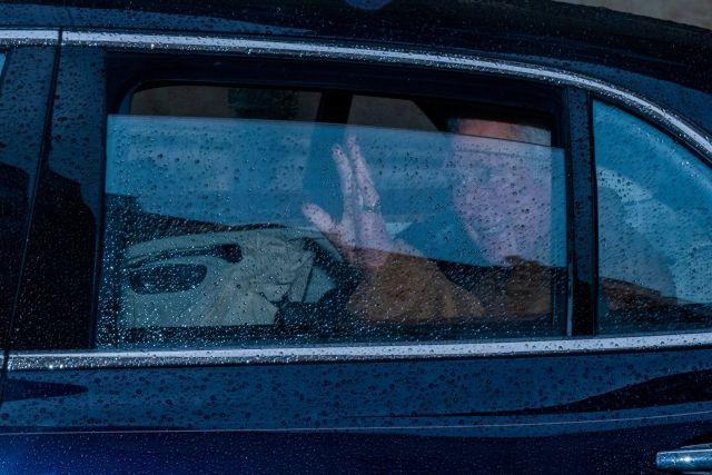 Prince Charles waves goodbye as he leaves Jesus College, Oxford.