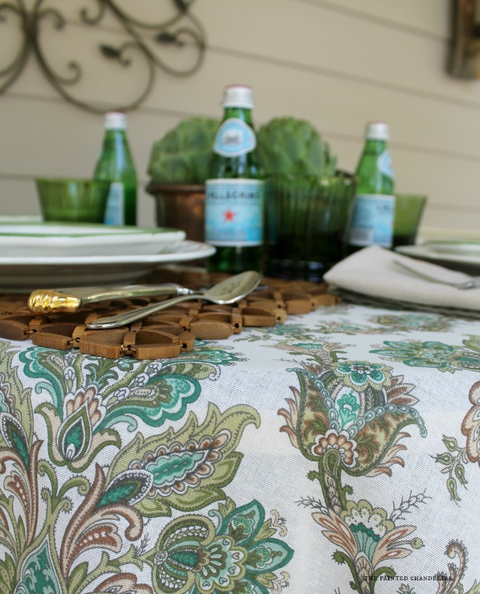 blurred-view-artichokes-table-setting-paisley-tablecloth-the-painted-chandelier