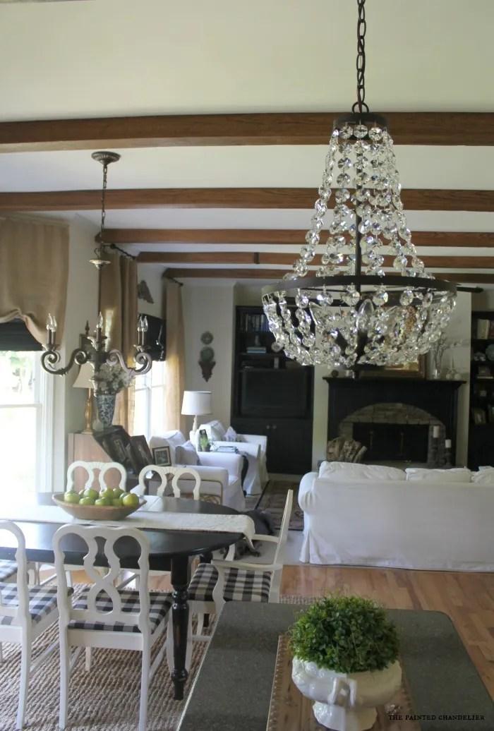 ballards-chandelier-over-island-with-az-faux-beams