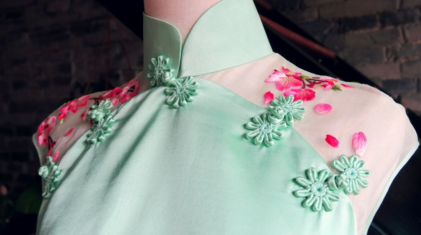 Close up shoulder detail ofmy mint and magenta modern wedding qipao