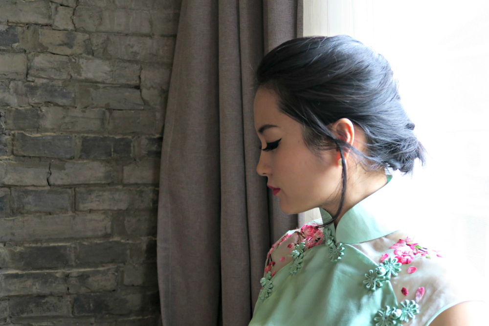Miranda's headshot on thepankou.com wearing mint green wedding qipao