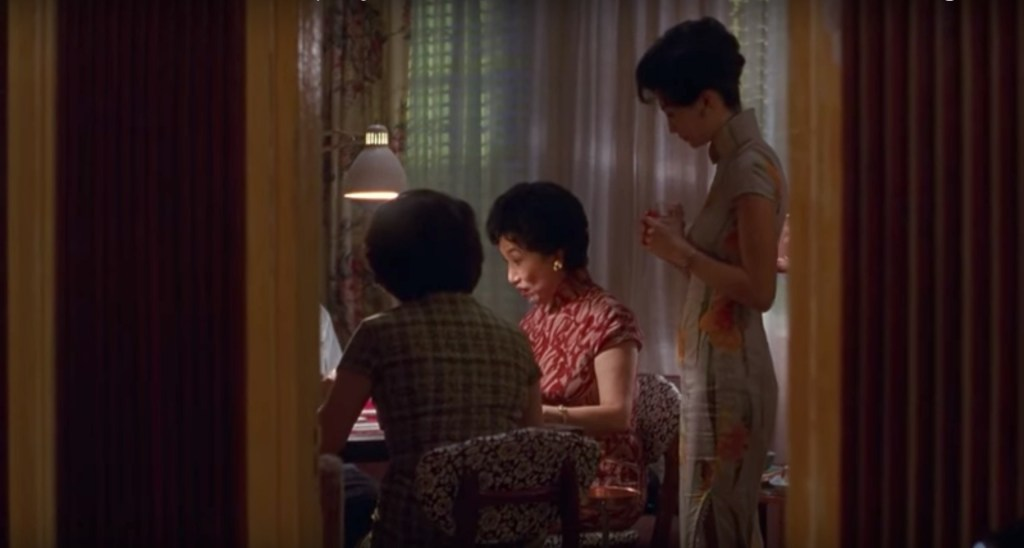 """Obsessed with """"In the Mood for Love""""? The orange floral qipao (cheongsam) from the complete list of 20 qipaos from the film. Click the link for more -"""
