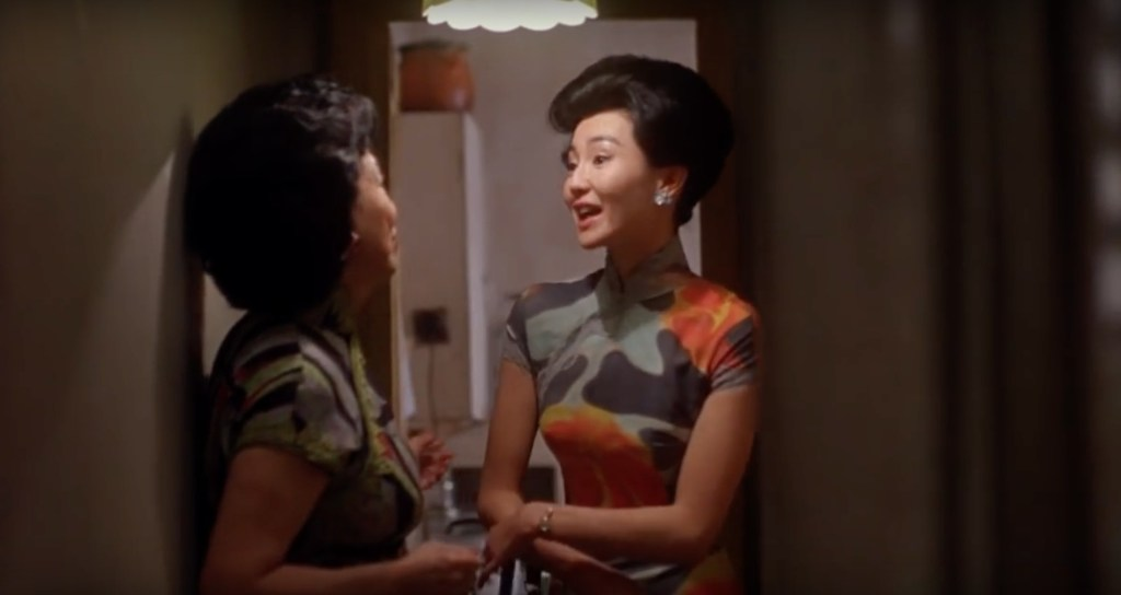 """Obsessed with """"In the Mood for Love""""? The qipao (cheongsam) with orange and grey qipao from the complete list of 20 qipaos from the film. Click the link for more -"""