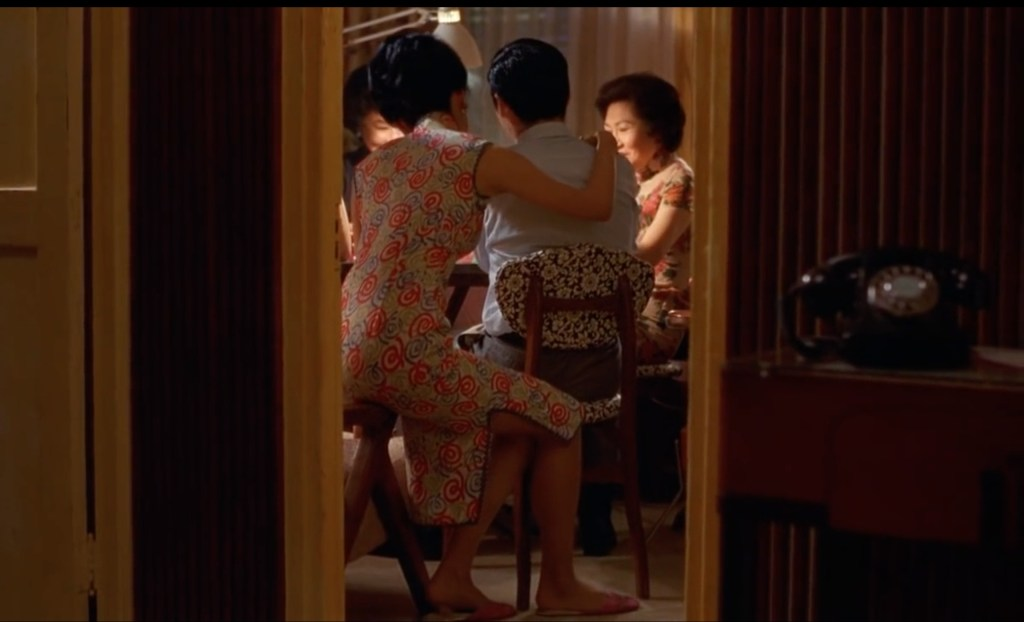 """Obsessed with """"In the Mood for Love""""? The qipao (cheongsam) with red-blue-green spirals from the complete list of 20 qipaos from the film. Click the link for more -"""
