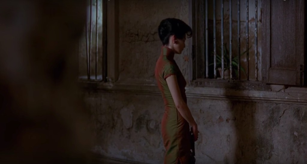 """Obsessed with """"In the Mood for Love""""? The olive qipao (cheongsam) with orange sheen from the complete list of 20 qipaos from the film. Click the link for more -"""