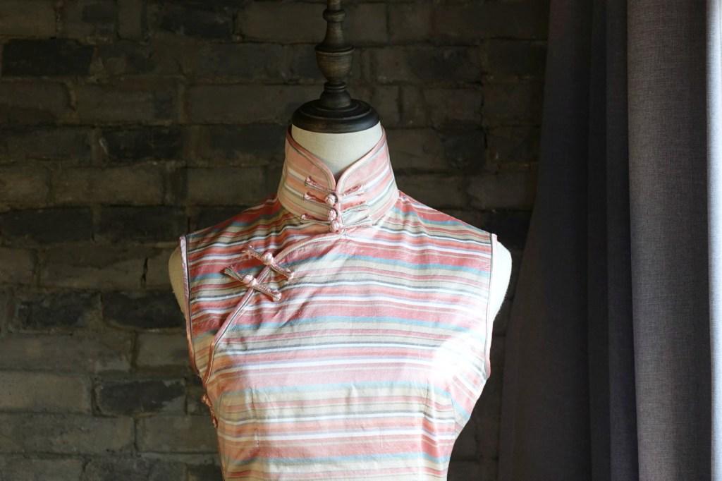 Pink striped sleeveless qipao cheongsam chest closeup