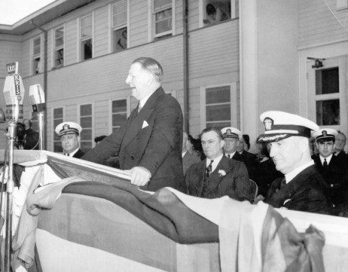 Secretary Knox gives speech while Captain Alva Bernhard looks on