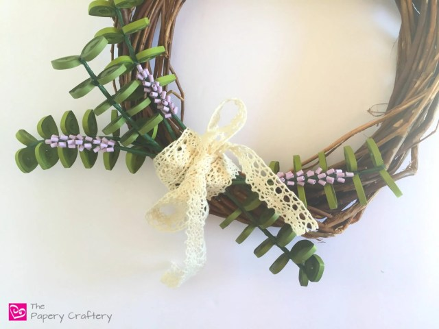 How to Use Quilling To Make a Wreath - Add quilling enhancements to a simple wreath form for easy front door decor -- www.thepaperycraftery.com