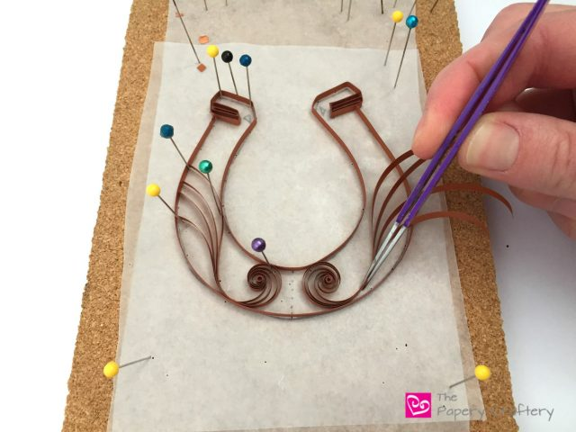 Quilling Paper Horseshoes ~ Your own quilling paper good luck charm! www.ThePaperyCraftery.com
