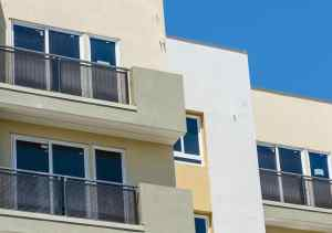 751993542_bigstock-New-Apartment-Building-46415998-300x211