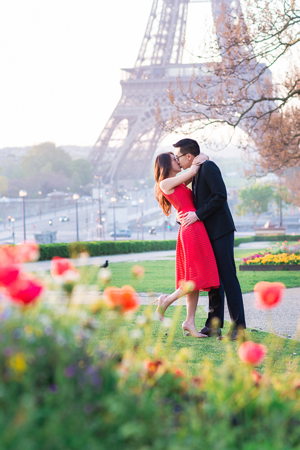 Girl in red dress kissing her fiance