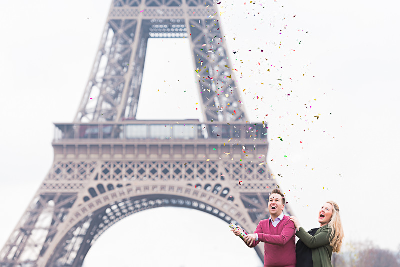 couple-celebrating-love-with-confetti-at-the-eiffel-tower