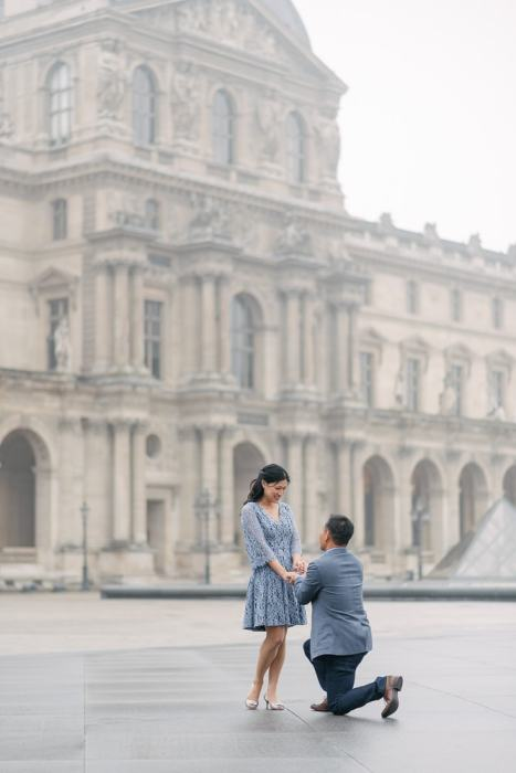 Paris proposal photographer - asian man one one knee proposing in the Louvre Museum courtyard