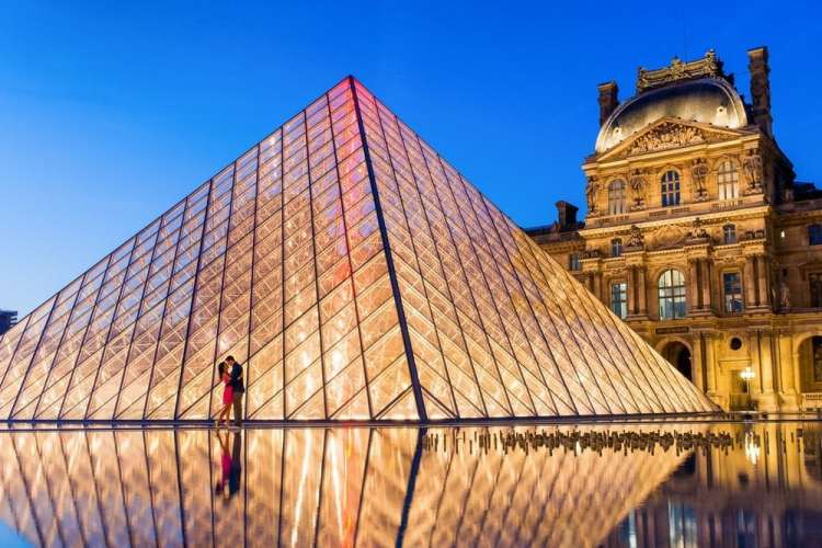 Proposal photographer Paris - night engagement photo by the Louvre Pyramid in Paris