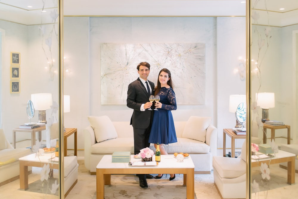 Recently engaged couple celebrating their engagement at Tiffany's on the champs elysees in Paris