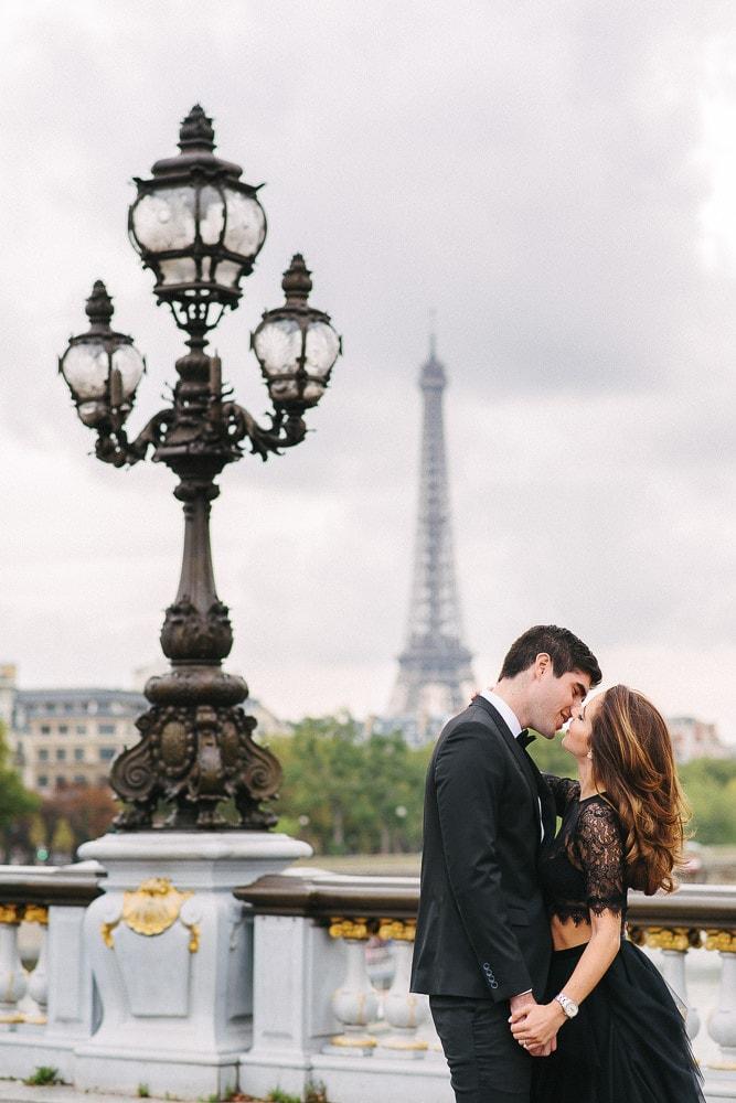 engagement photos paris couple from miami kissing in paris