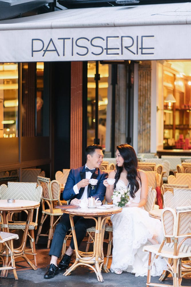 paris pre wedding bride and groom having coffee together at cafe carette