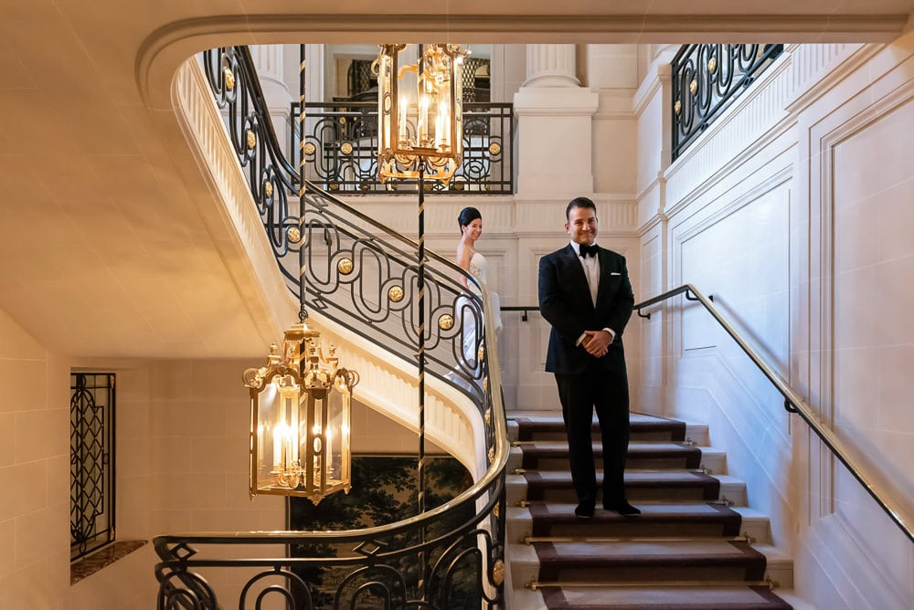 Bride and groom first look on the stairs of Hotel Crillon