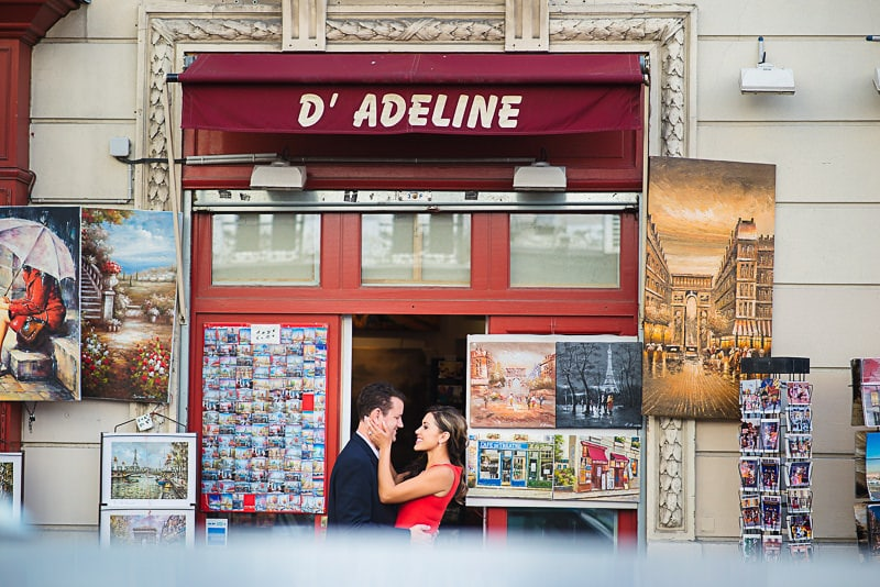 Couple kissing in front of souvenir shop at Montmartre