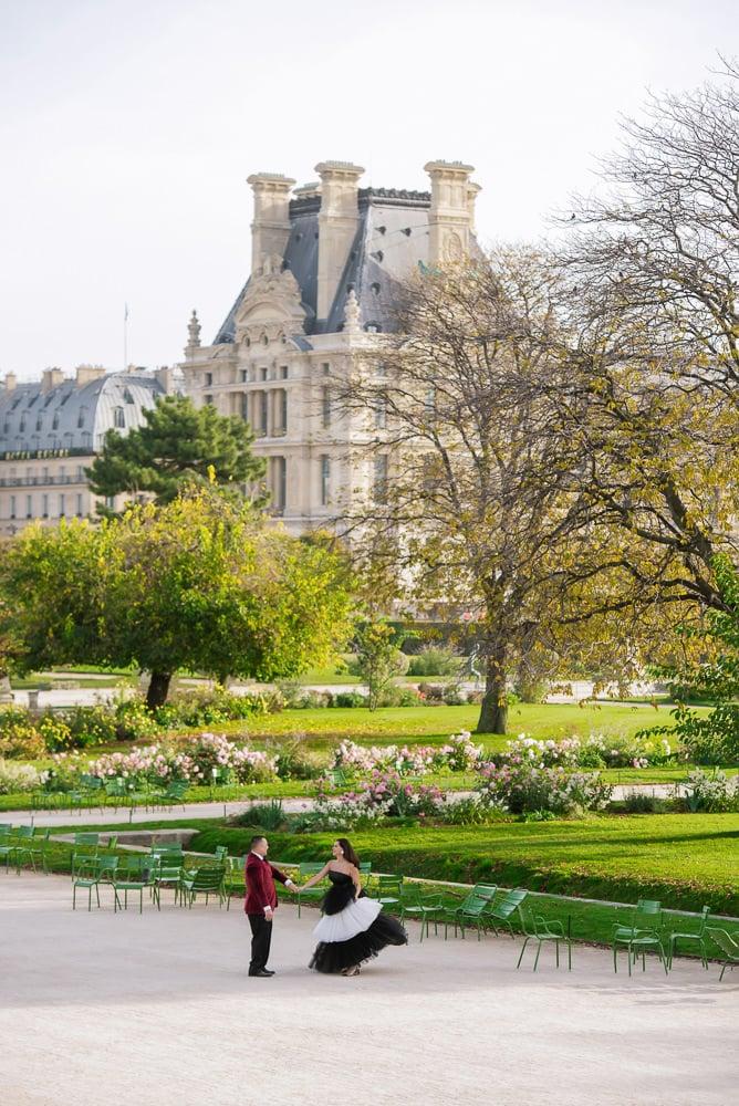 Young couple dancing in the Tuileries gardens, she is wearing Carolina Herrera dress