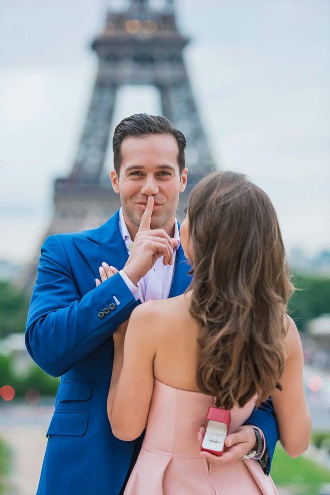 engaged in paris fun photo
