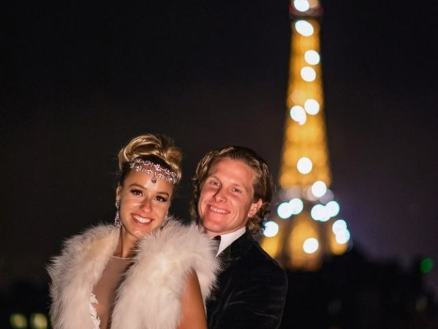The Peninsula Paris wedding - bride and groom portrait on the rooftop with sparkling eiffel tower behind