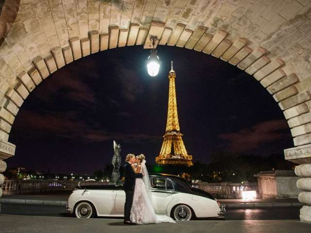 White Rolls Royce, the Eiffel Tower by night and a newly wed couple kissing passionately