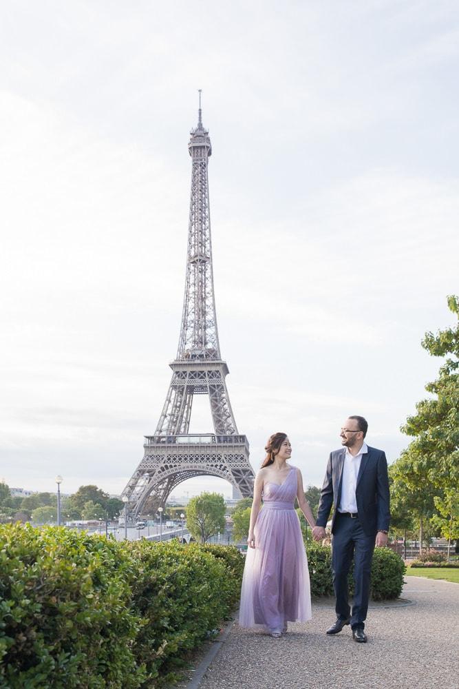 Bride and groom walking hand in hand in Paris