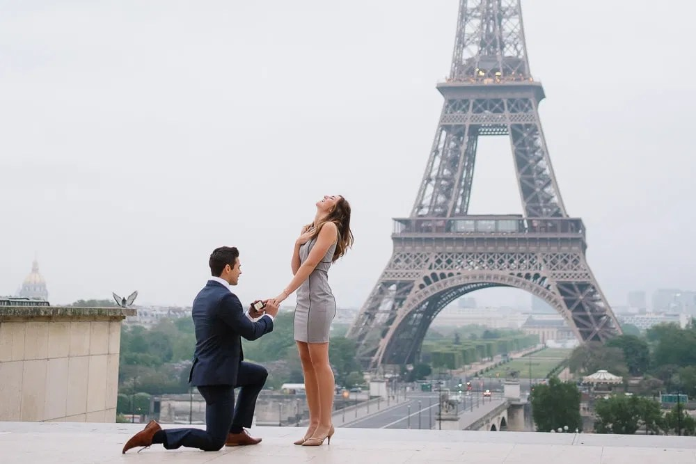Eiffel Tower proposal - Man on his knee asking his girlfriend to marry him