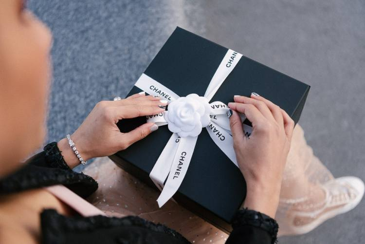 Chanel gift opening during personal branding photo shoot in Paris