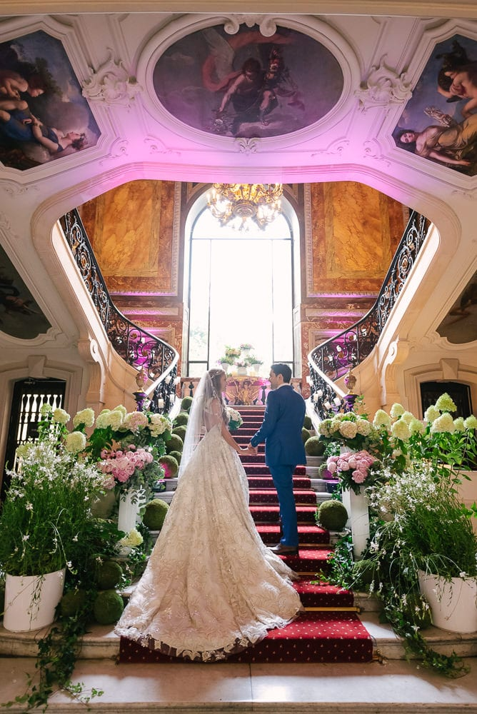 Bride and groom on the stairs of Hotel le Marois on their elopement day in Paris