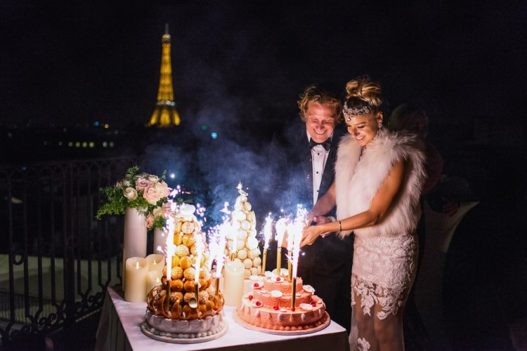 Croquembouche wedding cake being cut by bride and groom