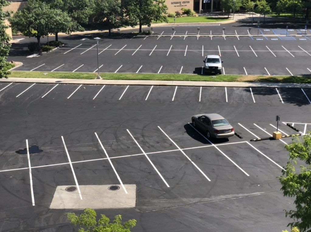 Parking lot with two cars