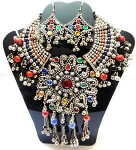 This Kuchi Tribal Necklace is colorful enough for the holidays.