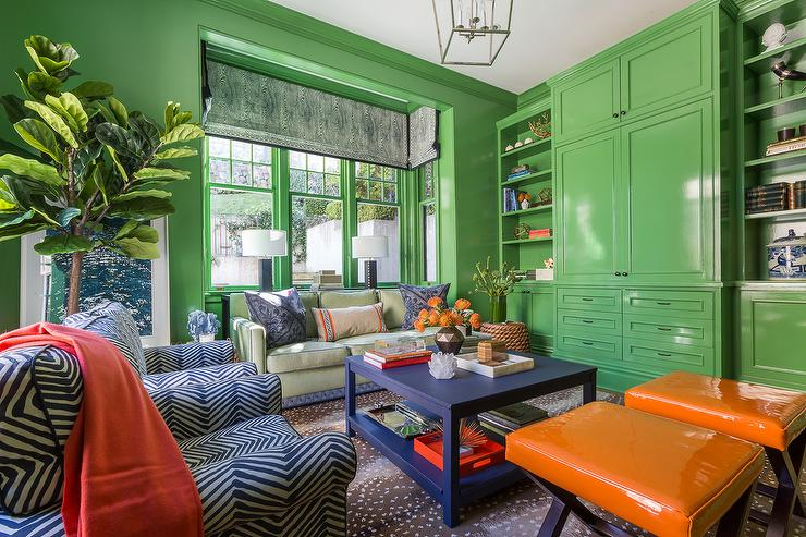 blue-orange-living-room-design-glossy-green-lacquer-built-in-cabinets-antelope-rug