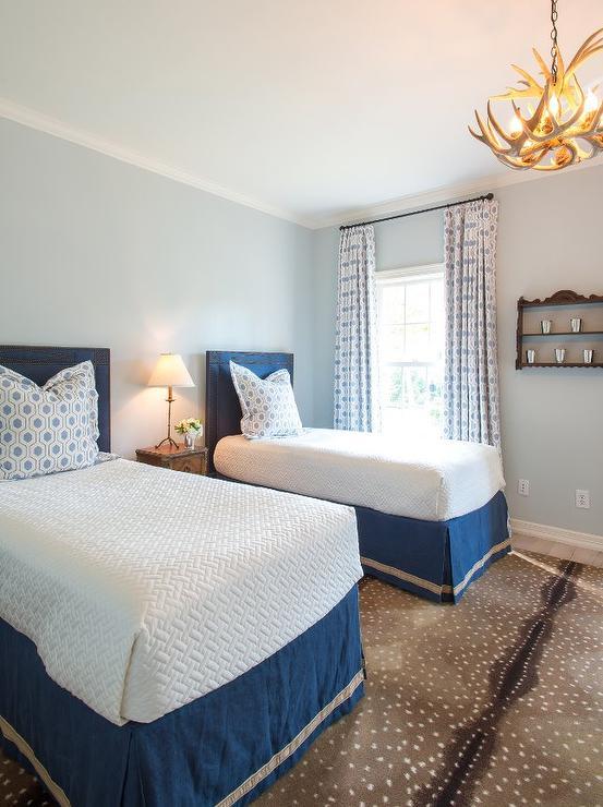 blue-twin-bedroom-antelope-rug-faux-antler-chandelier