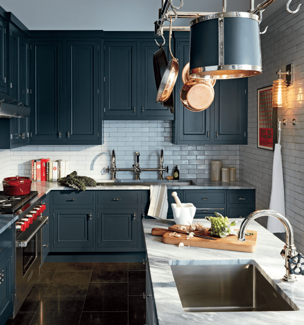 Great paint, a new stone counter top and beautiful accessories can make you love your kitchen all over again. Select a backsplash that is compatible with the style of the kitchen. Here, textured and glazed Grove Brickworks look great in their pale gray color palette.