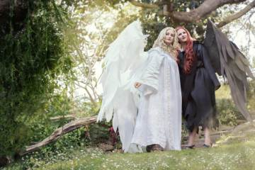 Photograph of Ardella and Echoing Artemis as angel and Dion respectively in flowing robes