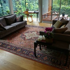The large tabriz in our client's sitting room adds to the lush and lux feel of the room.