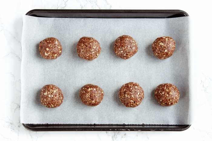 Chokladbollar, Swedish Chocolate balls on baking tray covered with parchment paper