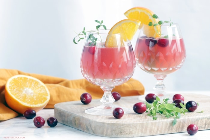 This Cranberry and Orange Vodka Cocktail is the perfect holiday drink to share with friends and family at your next party! Recipe from thepetitecook.com