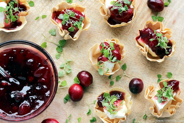 These light vegetarian Brie and Cranberry Cups are a wonderful way to entertain guests at your next dinner or holiday parties! Recipe from thepetitecook.com