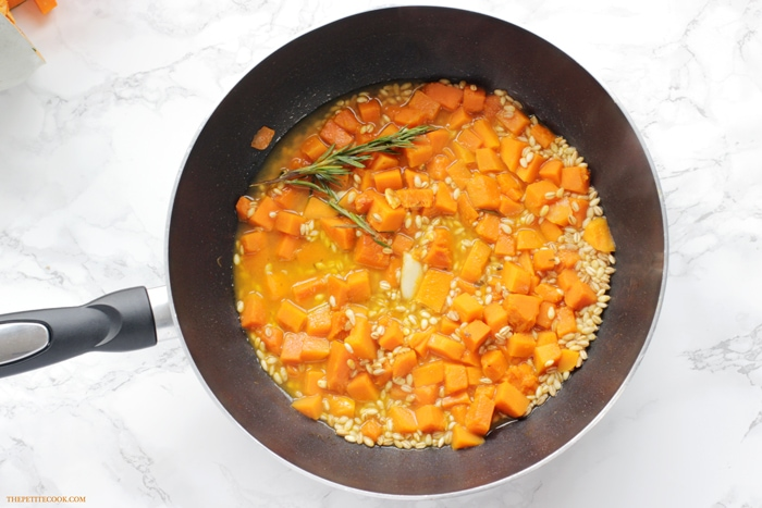This Barley Risotto with Pumpkin and Rosemary is vegan and dairy-free but incredibly flavorful and hearty. One of those comfort foods you can't possibly feel guilty about! Recipe from thepetitecook.com