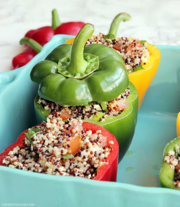 This vegetarian Quinoa Stuffed Bell Pepper recipe is perfect for a weeknight meal. Ridiculously easy to make, packed with awesome Mediterranean flavors and healthy goodness! recipe by thepetitecook.com