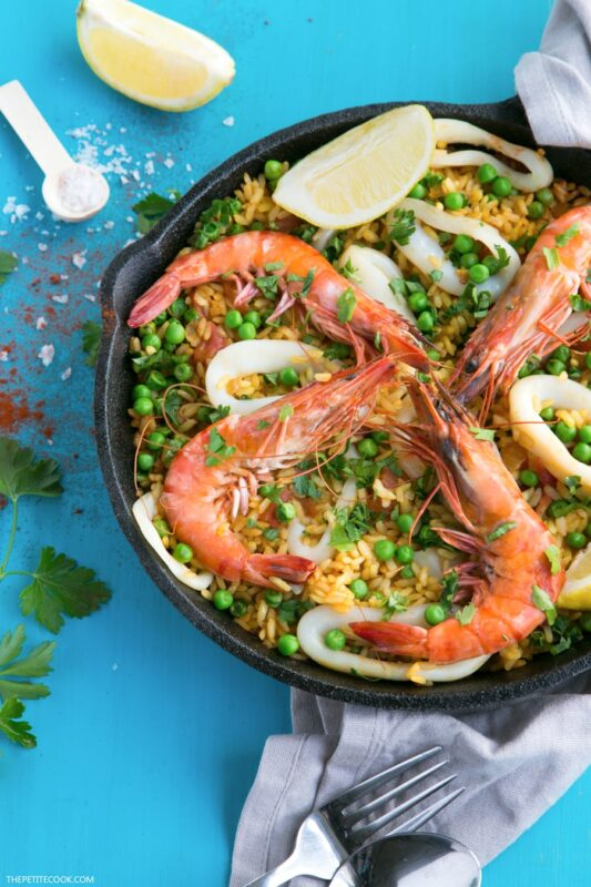 A Healthy Seafood Paella that's easy to put together with just 10 ingredients. This Spanish family favorite only takes less than 30 min to make and is great to enjoy all-year-round! Recipe from thepetitecook.com