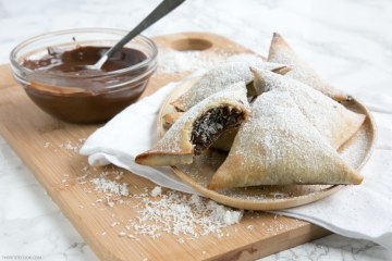 Nutella and coconut samosas served with melted chocolate on the side