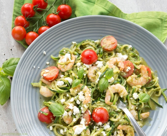 A new twist on a classic summer Italian dish without all the carbs - These Pesto Zucchini Noodles With Shrimps have the same flavors, same tastiness but totally gluten-free and so much healthier and lighter! Recipe from thepetitecook.com