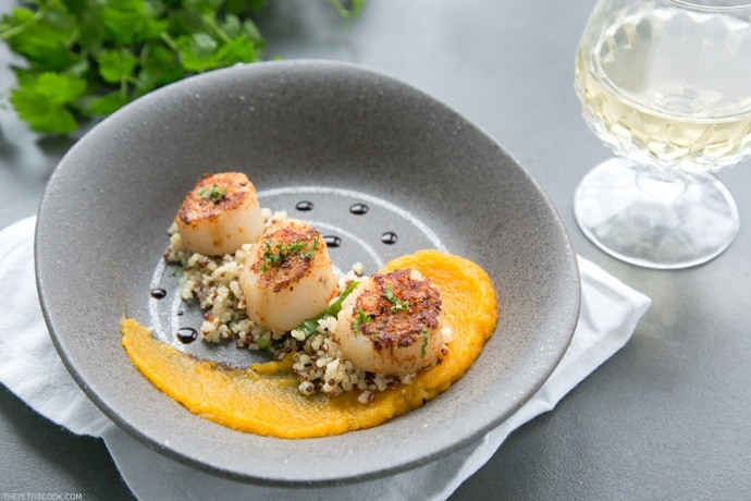 Packed with nutrients and bold vibrant flavors, these Spicy Scallops with Pumpkin Puree make a great gluten-free starter, and are sure to steal the show at your next dinner party! #glutenfree #seafood #pumpkin thepetitecook.com