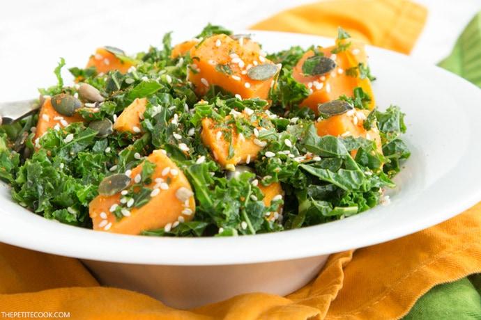sweet potato and kale salad on a white plate